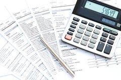 Calculator and pen Stock Photos