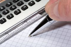 Calculator and pen. On a white background Stock Photo