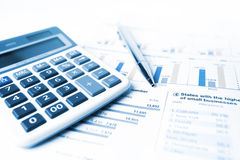 Calculator and pen Stock Images