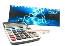 Calculator and a pen Stock Images