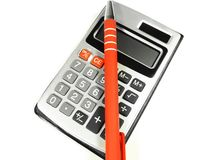 Calculator and pen. Close-up isolated on the white background Royalty Free Stock Images