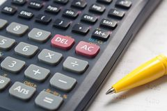 Calculator and pen. A calculator and a pen on a documents Stock Image