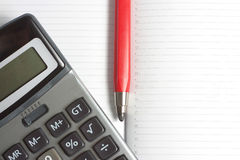 Calculator and pen Stock Photos