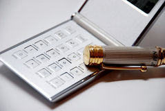 Calculator with pen Stock Images