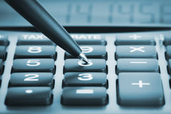 Calculator with pen Royalty Free Stock Image