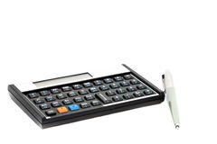 Calculator and Pen. A pen and a calculator isolated on a white background Royalty Free Stock Images