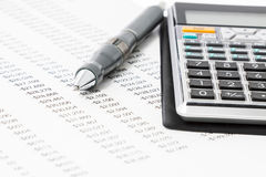 Calculator and Pen. A pen with a financial calculator Stock Images