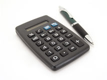 Calculator with pen Royalty Free Stock Images