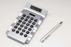 Calculator with pen. stock photography