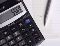 Calculator and pen. Stock Photo