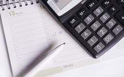 Calculator and pen. On the table. Business accessories Stock Images
