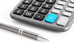 Calculator and pen. Stock Image
