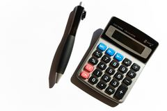 Calculator and pen. Accounting concept, ballpoint pen and calculator Royalty Free Stock Images