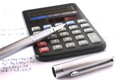 Calculator with pen and algebra. Equations Royalty Free Stock Photo