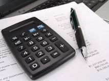 Calculator and pen with balance sheet Royalty Free Stock Images