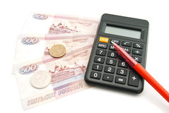 Calculator, pen, banknotes and coins Stock Image