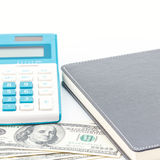 Calculator, pen and black notebook on dollar Stock Photography