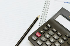 Calculator and pen on blank notebook Royalty Free Stock Photos