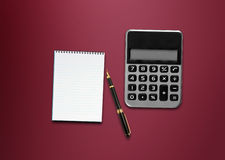 Calculator, a pen and blank paper Stock Image