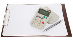 Calculator pen and a blank sheet. Calculator, pen and a blank sheet of paper on a clipboard, isolated Royalty Free Stock Images