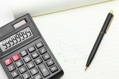 Calculator pen on book Stock Photography
