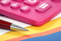 Calculator and pen on a business background Royalty Free Stock Photos