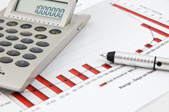 Calculator, pen and Business Chart Royalty Free Stock Photos