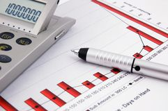 Calculator, pen and Business Chart Stock Images