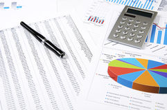 Calculator, pen and business charts, concept Royalty Free Stock Images