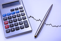 Calculator and pen on a chart Stock Image