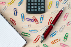 Calculator pen clip and notebook. On a light background stock images
