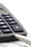 Calculator and pen close-up Royalty Free Stock Photo