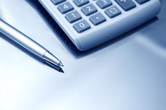 Calculator and pen. Close up. Royalty Free Stock Images