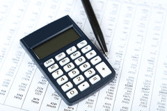 Calculator with pen, close up Stock Images