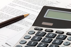 Calculator, pen and contract - business situation Stock Image
