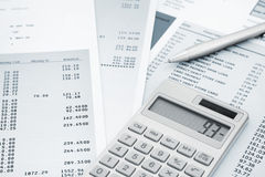 Calculator and Pen on and credit card statements Royalty Free Stock Photos