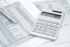 Calculator and Pen on and credit card statements Royalty Free Stock Image