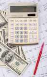 Calculator with pen and dollars Royalty Free Stock Photos