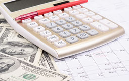 Calculator with pen and dollars Royalty Free Stock Image