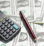 Calculator, pen at dollars Stock Photo