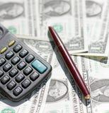 Calculator, pen at dollars stock photo