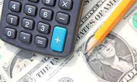Calculator, pen at dollars Royalty Free Stock Image