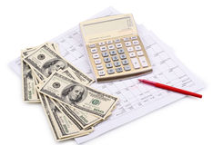 Calculator with pen and dollars Stock Photos