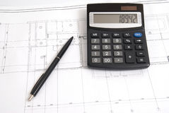 Calculator and pen on the drawing Royalty Free Stock Photos