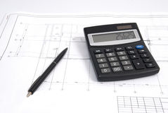 Calculator and pen on the drawing Stock Photo