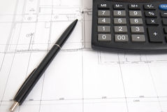 Calculator and pen on the drawing Royalty Free Stock Photography