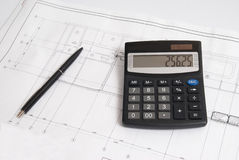 Calculator and pen on the drawing Stock Image