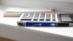 Calculator, pen en document blocnote Stock Foto