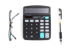 Calculator,pen and eye glasses Royalty Free Stock Photography