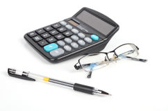 Calculator,pen and eye glasses Royalty Free Stock Photos